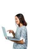 Smiling woman pointing at laptop Stock Photography