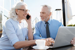 Smiling woman pointing on the laptop Stock Photos