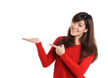 Smiling woman pointing product Royalty Free Stock Images