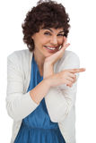 Smiling woman pointing something with her finger Royalty Free Stock Images