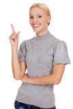 Smiling woman pointing at something interesting Stock Images