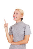 Smiling woman pointing at something interesting Stock Photo