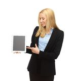 Smiling woman pointing at tablet pc Stock Image