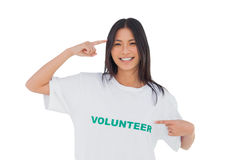 Smiling woman pointing to her volunteer tshirt Royalty Free Stock Photos