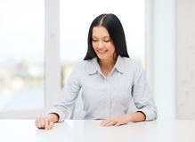 Smiling woman pointing to something imaginary Royalty Free Stock Photo