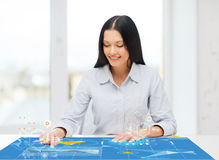 Smiling woman pointing to something imaginary Stock Photo