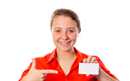 Smiling woman pointing to a white card Stock Images