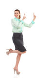 Smiling woman pointing up. Stock Image