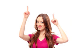 Smiling woman pointing up copy space Royalty Free Stock Photos