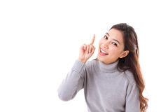 Smiling woman pointing up. White background with text space Stock Image
