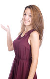 Smiling woman points a hand Royalty Free Stock Photos