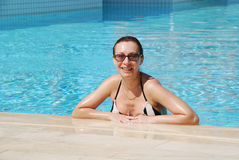 Smiling woman in pool royalty free stock photography