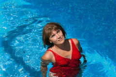 Smiling woman in the pool Stock Photos