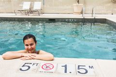 Smiling woman at the pool Royalty Free Stock Photography