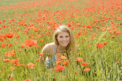 Smiling Woman  in poppy field Stock Images