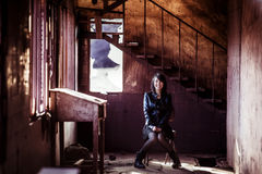 Smiling woman portrait. Young smiling woman inside rusty building Royalty Free Stock Photo