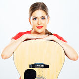 Smiling woman portrait with acoustic guitar . white background Royalty Free Stock Photography