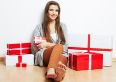 Smiling Woman portrait in christmas style with red, white box gi Stock Photos