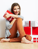 Smiling Woman portrait in christmas style with red, white box gi Royalty Free Stock Photo