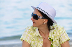Smiling woman portrait sunglasses white hat Royalty Free Stock Image