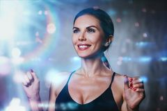 Smiling woman portrait. Young happy smiling brunette woman portrait with lights and flares effects Stock Photo