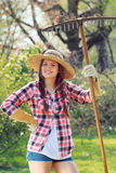 Smiling woman poses with a rake Stock Image