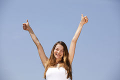 Smiling woman posing with both thumbs up Royalty Free Stock Photo