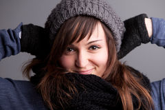 Smiling woman posing with hat and warm scarf Stock Photography