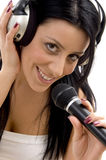 Smiling woman posing with headphone and microphone Stock Photography