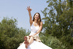 Smiling woman posing with the okay sign Royalty Free Stock Image