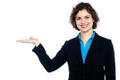 Smiling woman posing with open palm Royalty Free Stock Image