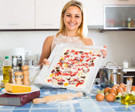 Smiling woman posing with pizza Stock Image