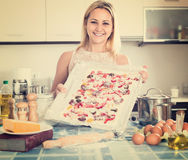 Smiling woman posing with pizza Royalty Free Stock Image