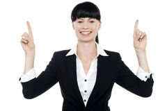 Smiling woman posing with raised fingers Stock Images