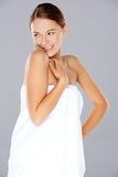 Smiling woman posing in a white towel Stock Photography
