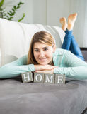 Smiling woman posing with word Stock Image