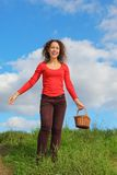 Smiling woman with pottle is walking outdoors Royalty Free Stock Photo