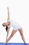 Smiling woman practicing yoga Royalty Free Stock Photo