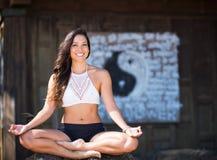 Smiling woman practicing Yoga Stock Photos