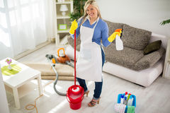 Smiling woman prepared for cleaning house royalty free stock image