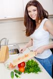 Smiling woman preparing fresh salad Royalty Free Stock Photography