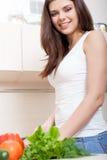 Smiling woman preparing salad Stock Photography