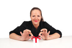 Smiling woman with present box in hands Stock Images
