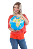 Smiling woman presenting a globe Stock Image