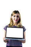 Smiling woman presenting her laptop Royalty Free Stock Images