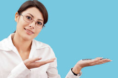 Smiling woman presenting something Stock Images