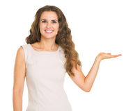 Smiling woman presenting something on empty palm Stock Photography