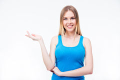 Smiling woman presenting something on the palm Stock Photography