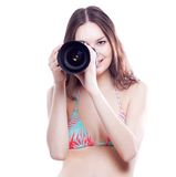 Smiling woman with professional camera Royalty Free Stock Image