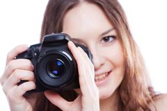 Smiling woman with professional camera Stock Image